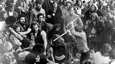 The Hell's Angels beating a fan with pool cues at Altamont