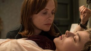 Isabelle Huppert and Chloë Grace Moretz in Greta, reviewed at Riot Material Magazine