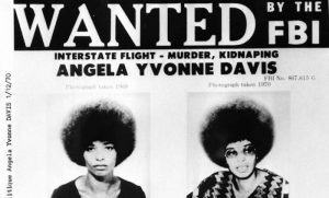 "Angela Davis answers the question, ""What does it mean to be a revolutionary,"" at Riot Material Magazine. Davis was jailed for more than a year on murder-conspiracy charges resulting from a San Rafael courthouse slaying of a judge and three others. She faced the death penalty, but was acquitted."