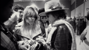 Sharon Stone and Bob Dylan. Rolling Thunder Revue: A Bob Dylan Story by Martin Scorsese is reviewed at Riot Material, LA's premier magazine for art and film.