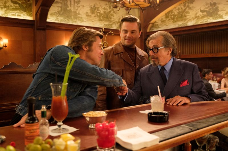 Leonardo DiCaprio, Brad Pitt and Al Pacino in Once Upon A Time in Hollywood. A review of the film is at Riot Material, LA's premier magazine for art and film.