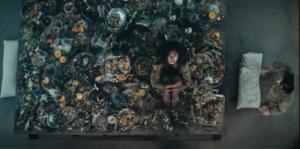 Alexandra Masangkay in The Platform (El Hoyo) 2019, reviewed at Riot Material, LA's premier magazine for art and film,