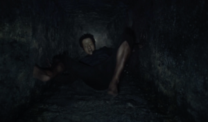 "Man climbing out of the well in Jonathan Glazer's ""The Fall,"" reviewed at Riot Material, LA's premier magazine for art and film"