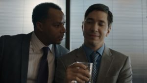 Donald Faison and Justin Long in The Wave (2019), reviewed at Riot Material magazine.
